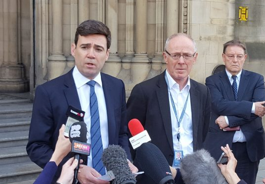 Mayor of Greater Manchester, Andy Burnham, flanked by Manchester City Council leader Richard Leese and Harpurhey councillor Pat Karney